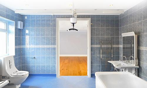Height adjustable bath and ceiling hoist occupational therapist