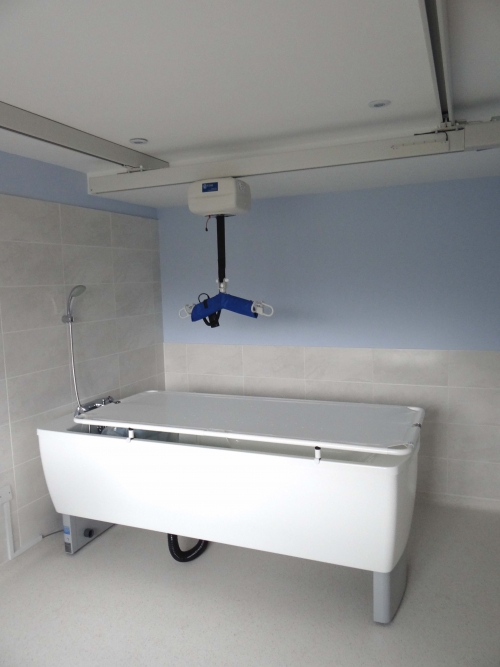 Changing Stretcher Integrated onto a Height Adjustable Bath with a Ceiling Hoist